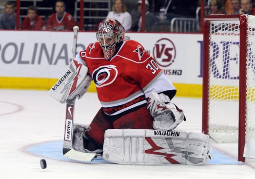 RALEIGH, NC - APRIL 26: Goalie Cam Ward # 30 of the Carolina Hurricanes deflects a shot from the New Jersey Devils during the firrst period of Game Six of the Eastern Conference Quarterfinals of the 2009 Stanley Cup Playoffs on April 26, 2009 at the RBC Center in Raleigh, North Carolina. (Photo by Steve Dykes/Getty Images)