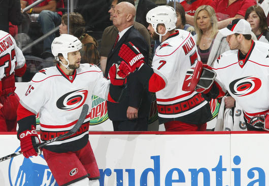 NEWARK, NJ - APRIL 28:  Tuomo Ruutu #15 of the Carolina Hurricanes is congratulated by teammate Niclas Wallin #7 after scoring at 1:02 in the first period against the New Jersey Devils during Game Seven of the Eastern Conference Quarterfinal Round of the 2009 Stanley Cup Playoffs at the Prudential Center on April 28, 2009 in Newark, New Jersey.  (Photo by Andy Marlin/NHLI via Getty Images)