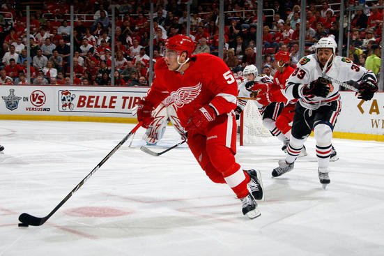 DETROIT - MAY 27:  Valtteri Filppula #51 of the Detroit Red Wings skates with the puck ahead of Dustin Byfuglien #33 of the Chicago Blackhawks during Game Five of the Western Conference Championship Round of the 2009 Stanley Cup Playoffs on May 27, 2009 at Joe Louis Arena in Detroit, Michigan.  (Photo by Gregory Shamus/Getty Images)