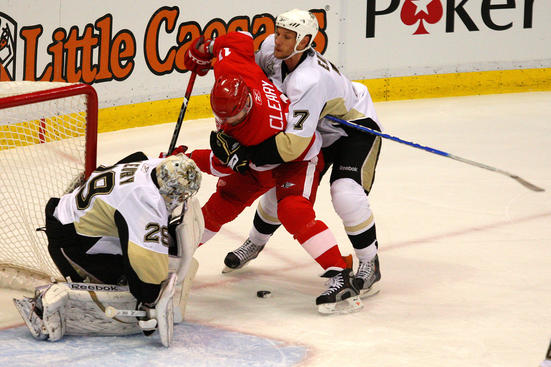 Dan Cleary of the Detroit Red Wings takes a shot against Mark Eaton and goaltender Marc-Andre Fleury of the Pittsburgh Penguins during Game Five of the 2009 NHL Stanley Cup Final.  (Photo by Jim McIsaac/Getty Images)
