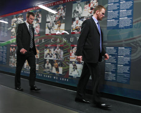 VANCOUVER, CANADA - APRIL 17: Daniel Sedin (R) #22 and his twin brother Henrik Sedin #33 of the Vancouver Canucks walk into the rink together before Game Two of the Western Conference Quarterfinals between the Vancouver Canucks and the Los Angeles Kings during the 2010 Stanley Cup Playoffs at General Motors Place on April 17, 2010 in Vancouver, British Columbia, Canada. Photo by Jeff Vinnick/NHLI via Getty Images)