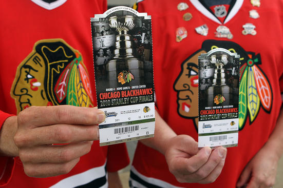 CHICAGO - MAY 31: (L-R) Jeff Triebe and Rick Triebe of Illinois hold up their tickets for Game Two of the 2010 NHL Stanley Cup Final between the Chicago Blackhawks and the Philadelphia Flyers at the United Center on May 31, 2010 in Chicago, Illinois. (Photo by Bruce Bennett/Getty Images)