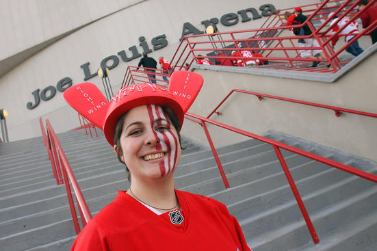 DETROIT, MI - APRIL 13: A fan gets set to enter the arena to see the Phoenix Coyotes play the Detroit Red Wings in Game One of the Western Conference Quarterfinals during the 2011 NHL Stanley Cup Playoffs at at Joe Louis Arena on April 13, 2011 in Detroit, Michigan.(Photo By Dave Sandford/Getty Images)