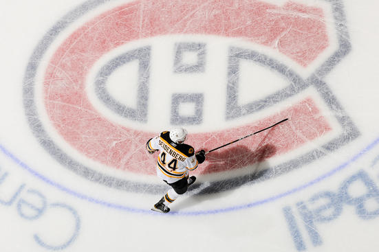 MONTREAL, CANADA - APRIL 26: Dennis Seidenberg #44 of the Boston Bruins skates on the Montreal Canadiens Logo before Game Six of the Eastern Conference Quarterfinals during the 2011 NHL Stanley Cup Playoffs at the Bell Centre on April 26, 2011 in Montreal, Quebec, Canada. (Photo by Francois Lacasse/NHLI via Getty Images)