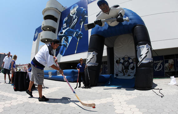 TAMPA, FL - MAY 21: A fan shoots a ball with a hockey stick at a display in Game Four of the Eastern Conference Finals between the Tampa Bay Lightning and the Boston Bruins during the 2011 NHL Stanley Cup Playoffs at St Pete Times Forum on May 21, 2011 in Tampa, Florida. (Photo by Eliot J. Schechter/Getty Images)