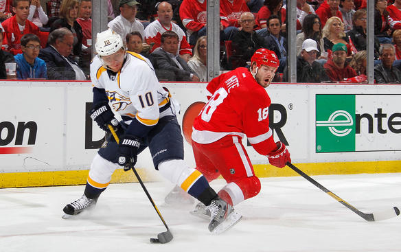 DETROIT, MI - APRIL 17: Martin Erat #10 of the Nashville Predators controls the puck in front of Ian White #18 of the Detroit Red Wings during the first period in Game Four of the Western Conference Quarterfinals during the 2012 NHL Stanley Cup Playoffs at Joe Louis Arena on April 17, 2012 in Detroit, Michigan. (Photo by Gregory Shamus/Getty Images)
