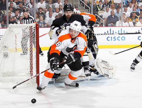 PITTSBURGH, PA - APRIL 20:  Danny Briere #48 of the Philadelphia Flyers reaches for the loose puck in front of Brian Strait #37 of the Pittsburgh Penguins in Game Five of the Eastern Conference Quarterfinals during the 2012 NHL Stanley Cup Playoffs at Consol Energy Center on April 20, 2012 in Pittsburgh, Pennsylvania.  (Photo by Gregory Shamus/NHLI via Getty Images)