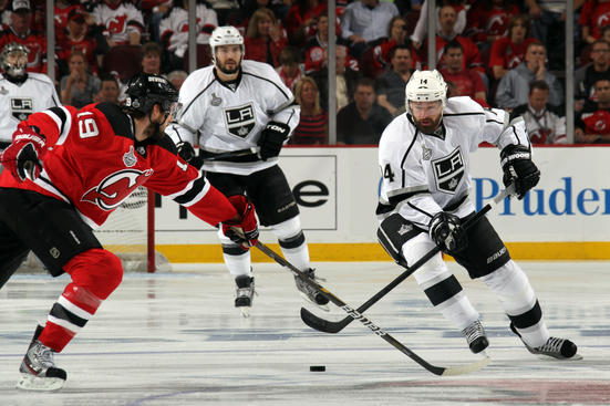 NEWARK, NJ - MAY 30: Zach Parise #9 of the New Jersey Devils fights for position with Jonathan Quick #32 of the Los Angeles Kings during Game One of the 2012 NHL Stanley Cup Final at the Prudential Center on May 30, 2012 in Newark, New Jersey.  (Photo by Paul Bereswill/Getty Images)