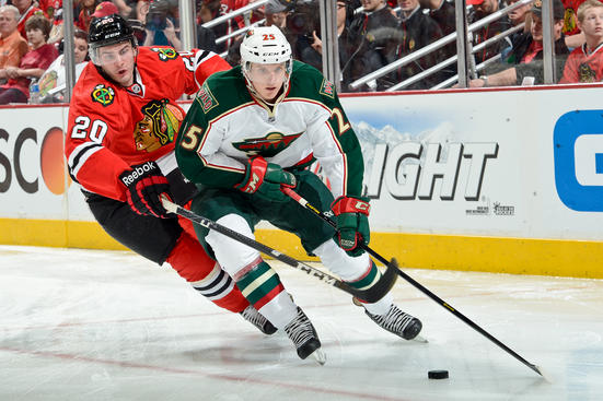 CHICAGO, IL - APRIL 30: Jonas Brodin #25 of the Minnesota Wild approaches the puck as Brandon Saad #20 of the Chicago Blackhawks reaches from behind in Game One of the Western Conference Quarterfinals during the 2013 Stanley Cup Playoffs at the United Center on April 30, 2013 in Chicago, Illinois. (Photo by Bill Smith/NHLI via Getty Images)