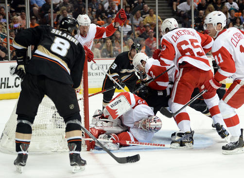 ANAHEIM, CA - MAY 02:  Jimmy Howard #35 of the Detroit Red Wings smothers the puck in the crease while Teemu Selanne #8 of the Anaheim Ducks looks for a rebound during the first period in Game Two of the Western Conference Quarterfinals during the 2013 Stanley Cup Playoffs at Honda Center on May 2, 2013 in Anaheim, California.  (Photo by Harry How/Getty Images)