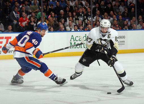 UNIONDALE, NY - MAY 05: Sidney Crosby #87 of the Pittsburgh Penguins moves around Michael Grabner #40 of the New York Islanders in Game Three of the Eastern Conference Quarterfinals during the 2013 NHL Stanley Cup Playoffs at the Nassau Veterans Memorial Coliseum on May 5, 2013 in Uniondale, New York.  (Photo by Bruce Bennett/Getty Images)