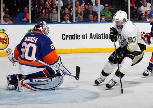 UNIONDALE, NY - MAY 11:  Evgeni Nabokov #20 of the New York Islanders stops Sidney Crosby #87 of the Pittsburgh Penguins on a breakaway in the first period in Game Six of the Eastern Conference Quarterfinals during the 2013 NHL Stanley Cup Playoffs at Nassau Veterans Memorial Coliseum on May 11, 2013 in Uniondale, New York. Jarome Iginla #12 of the  Penguins picked up the rebound and scored.  (Photo by Paul Bereswill/Getty Images)