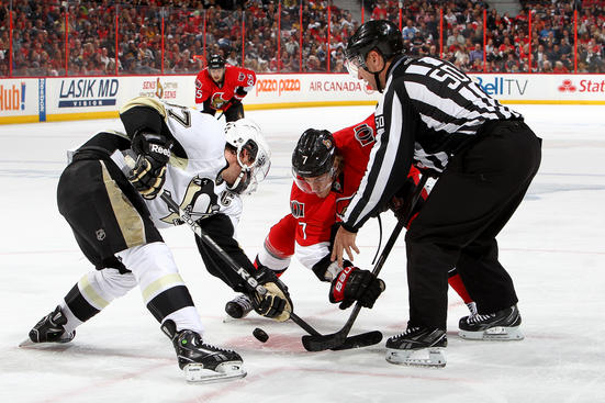 OTTAWA, CANADA - MAY 19: Kyle Turris #7 of the Ottawa Senators takes a faceoff against Sidney Crosby #87 of the Pittsburgh Penguins in Game Three of the Eastern Conference Semifinals during the 2013 NHL Stanley Cup Playoffs at Scotiabank Place on May 19, 2013 in Ottawa, Ontario, Canada.  (Photo by Francois Laplante/NHLI via Getty Images)