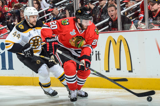 CHICAGO, IL - JUNE 15: Brandon Saad #20 of the Chicago Blackhawks approaches the puck as Dennis Seidenberg #44 of the Boston Bruins follows behind in Game Two of the Stanley Cup Final at the United Center on June 15, 2013 in Chicago, Illinois. (Photo by Bill Smith/NHLI via Getty Images)