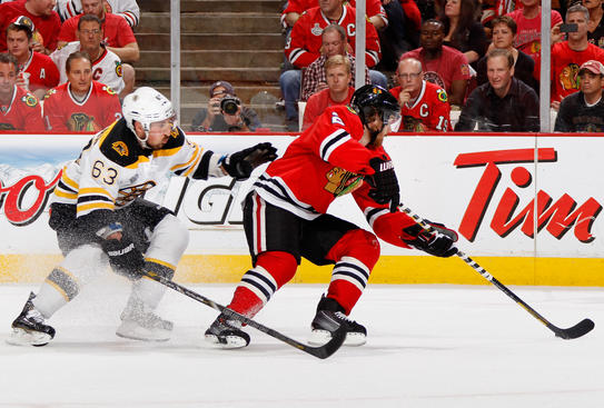 BOSTON, MA - JUNE 22:  Brad Marchand #63 of the Boston Bruins skates after Duncan Keith #2 of the Chicago Blackhawks during the first period of Game Five of the 2013 Stanley Cup Final at TD Garden on June 22, 2013 in Boston, Massachusetts.  (Photo by Dave Sandford/NHLI via Getty Images)