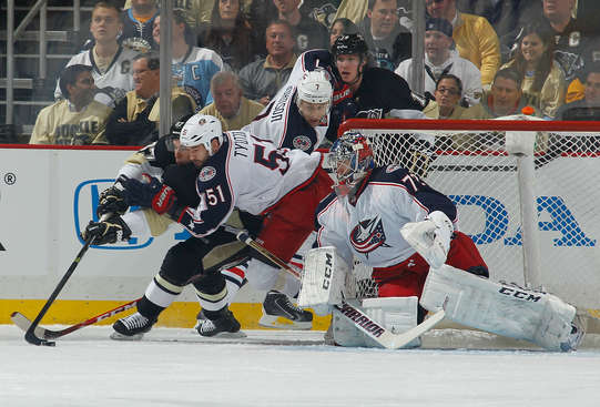 PITTSBURGH, PA - APRIL 16:  Sidney Crosby #87 of the Pittsburgh Penguins moves the puck in front of Jack Johnson #7, Fedor Tyutin #5, and Sergei Bobrovsky #72 of the Columbus Blue Jackets on April 16 2014 at Consol Energy Center in Pittsburgh, Pennsylvania.  (Photo by Gregory Shamus/NHLI via Getty Images)