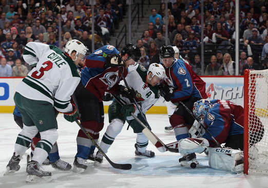 DENVER, CO - APRIL 19:  Goalie Semyon Varlamov #1 of the Colorado Avalanche collects the puck as Zach Parise #11 of the Minnesota Wild and Charlie Coyle #3 of the Minnesota Wild pressure the goal and Nick Holden #2 and Jan Hejda #8 of the Colorado Avalanche help defend in Game Two of the First Round of the 2014 NHL Stanley Cup Playoffs at Pepsi Center on April 19, 2014 in Denver, Colorado.  (Photo by Doug Pensinger/Getty Images)