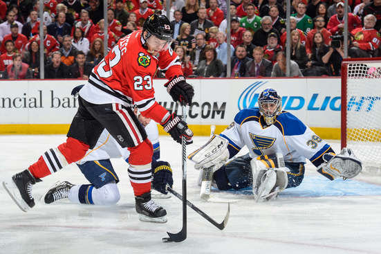 CHICAGO, IL - APRIL 23: Kris Versteeg #23 of the Chicago Blackhawks grabs the puck next to goalie Ryan Miller #39 of the St. Louis Blues in Game Four of the First Round of the 2014 Stanley Cup Playoffs at the United Center on April 23, 2014 in Chicago, Illinois. (Photo by Bill Smith/NHLI via Getty Images)