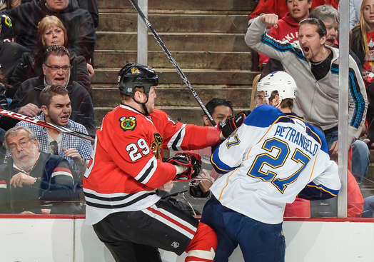 CHICAGO, IL - APRIL 27: Bryan Bickell #29 of the Chicago Blackhawks gets physical with Alex Pietrangelo #27 of the St. Louis Blues in Game Six of the First Round of the 2014 Stanley Cup Playoffs at the United Center on April 27, 2014 in Chicago, Illinois. (Photo by Bill Smith/NHLI via Getty Images)