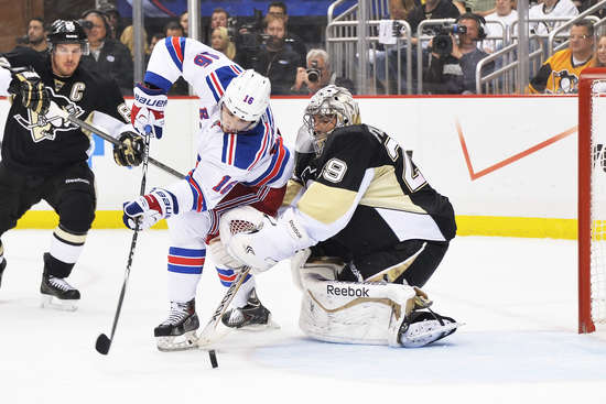 PITTSBURGH, PA - MAY 9:  Derick Brassard #16 of the New York Rangers scores a goal on goaltender Marc-Andre Fleury #29 of the Pittsburgh Penguins in the first period in Game Five of the Second Round of the 2014 NHL Stanley Cup Playoffs on May 9, 2014 at CONSOL Energy Center in Pittsburgh, Pennsylvania.  (Photo by Jamie Sabau/Getty Images)