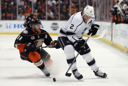 ANAHEIM, CA - MAY 12:  Matt Greene #2 of the Los Angeles Kings is pursued by Saku Koivu #11 of the Anaheim Ducks for the puck in the first period of Game Five of the Second Round of the 2014 NHL Stanley Cup Playoffs at Honda Center on May 12, 2014 in Anaheim, California.  (Photo by Jeff Gross/Getty Images)