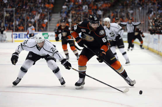 Patrick Maroon #62 of the Anaheim Ducks is pursued by Slava Voynov #26 of the Los Angeles Kings for the puck in the first period of Game Seven of the Second Round of the 2014 NHL Stanley Cup Playoffs at Honda Center on May 16, 2014 in Anaheim, California.  (Photo by Getty Images)