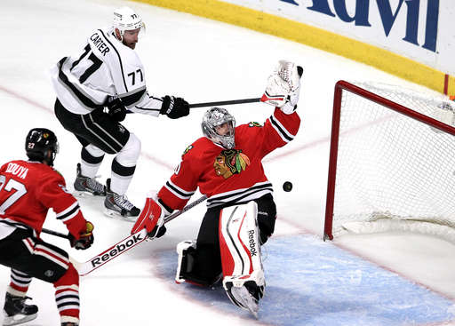 CHICAGO, IL - JUNE 01:  Jeff Carter #77 of the Los Angeles Kings scores a goal against Corey Crawford #50 of the Chicago Blackhawks in the first period during Game Seven of the Western Conference Final in the 2014 Stanley Cup Playoffs at United Center on June 1, 2014 in Chicago, Illinois.  (Photo by Tasos Katopodis/Getty Images)