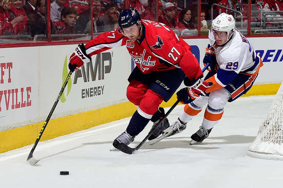 WASHINGTON, DC - APRIL 15:  Karl Alzner #27 of the Washington Capitals and Brock Nelson #29 of the New York Islanders battle for the puck during the first period in Game One of the Eastern Conference Quarterfinals during the 2015 NHL Stanley Cup Playoffs at Verizon Center on April 15, 2015 in Washington, DC.  (Photo by Patrick McDermott/NHLI via Getty Images)