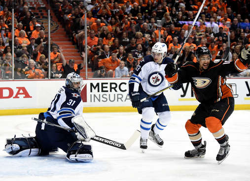 ANAHEIM, CA - APRIL 16:  Ondrej Pavelec #3 and Ben Chiarot #63 of the Winnipeg Jets and Emerson Etem #16 of the Anaheim Ducks react to a goal by Sami Vatanen #45 during the first period in Game One of the Eastern Conference Quarterfinals during the 2015 NHL Stanley Cup Playoffs at Honda Center on April 16, 2015 in Anaheim, California.  (Photo by Harry How/Getty Images)