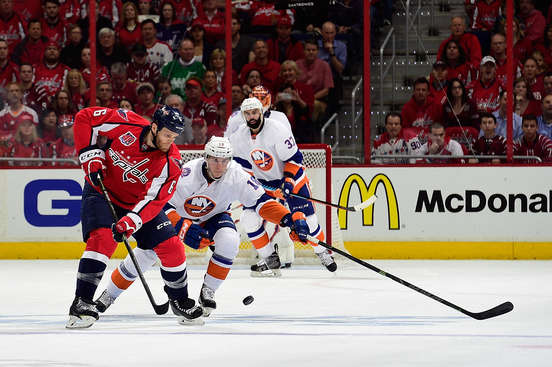 WASHINGTON, DC - APRIL 17:  Tim Gleason #6 of the Washington Capitals and Ryan Strome #18 of the New York Islanders battle for the puck during the first period in Game Two of the Eastern Conference Quarterfinals during the 2015 NHL Stanley Cup Playoffs at Verizon Center on April 17, 2015 in Washington, DC.  (Photo by Patrick McDermott/NHLI via Getty Images)