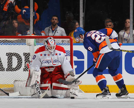 UNIONDALE, NY - APRIL 19: Braden Holtby #70 of the Washington Capitals blocks the net against Brock Nelson #29 of the New York Islanders in Game Three of the Eastern Conference Quarterfinals during the 2015 NHL Stanley Cup Playoffs at the Nassau Veterans Memorial Coliseum on April 19, 2015 in Uniondale, New York.  (Photo by Bruce Bennett/Getty Images)