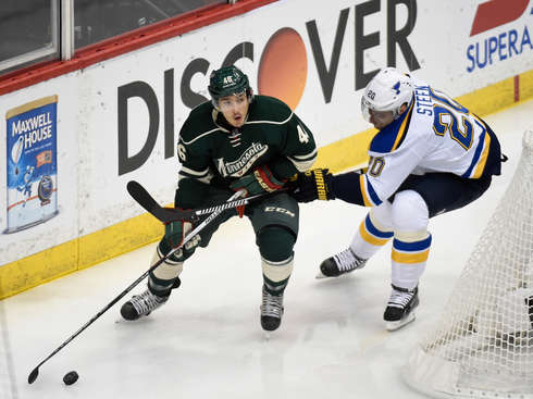ST PAUL, MN - APRIL 22:  Jared Spurgeon #46 of the Minnesota Wild controls the puck against Alexander Steen #20 of the St. Louis Blues during the first period in Game Four of the Western Conference Quarterfinals during the 2015 NHL Stanley Cup Playoffs on April 22, 2015 at Xcel Energy Center in St Paul, Minnesota.  (Photo by Hannah Foslien/Getty Images)