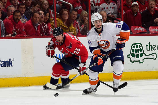 WASHINGTON, DC - APRIL 23:  Tyler Kennedy #26 of the New York Islanders controls the puck against Jason Chimera #25 of the Washington Capitals during the first period in Game Five of the Eastern Conference Quarterfinals during the 2015 NHL Stanley Cup Playoffs at Verizon Center on April 23, 2015 in Washington, DC.  (Photo by Patrick McDermott/NHLI via Getty Images)