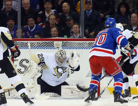 NEW YORK, NY - APRIL 24: Marc-Andre Fleury #29 of the Pittsburgh Penguins makes the first period save on J.T. Miller #10 of the New York Rangers in Game Five of the Eastern Conference Quarterfinals during the 2015 NHL Stanley Cup Playoffs at Madison Square Garden on April 24, 2015 in New York City.  (Photo by Bruce Bennett/Getty Images)