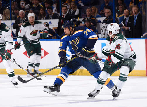 ST. LOUIS, MO - APRIL 24: Ryan Reaves #75 of the St. Louis Blues attempts to block a pass by Jared Spurgeon #46 of the Minnesota Wild in Game Five of the Western Conference Quarterfinals during the 2015 NHL Stanley Cup Playoffs on April 24, 2015 at the Scottrade Center in St. Louis, Missouri. (Photo by Scott Rovak/NHLI via Getty Images)
