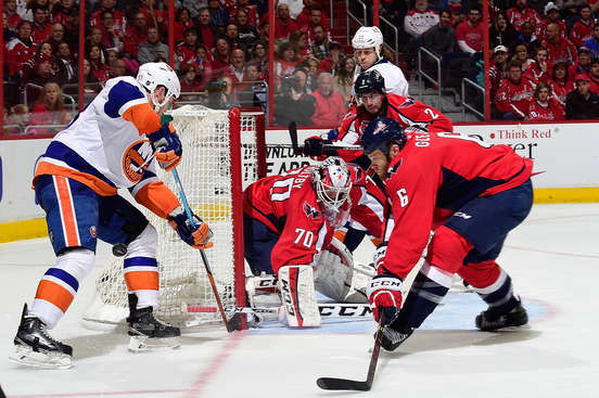 WASHINGTON, DC - APRIL 27:  Braden Holtby #70 of the Washington Capitals makes a save against Casey Cizikas #53 of the New York Islanders during the first period in Game Seven of the Eastern Conference Quarterfinals during the 2015 NHL Stanley Cup Playoffs at Verizon Center on April 27, 2015 in Washington, DC.  (Photo by Patrick McDermott/NHLI via Getty Images)