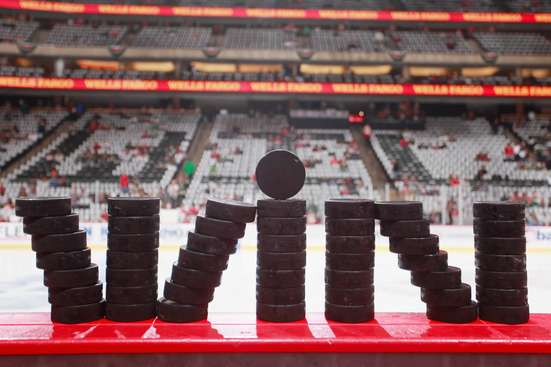 ST. PAUL, MN - MAY 7: Pucks are set up for the Minnesota Wild prior to Game Four of the Western Conference Semifinals during the 2015 NHL Stanley Cup Playoffs against the Chicago Blackhawks on May 7, 2015 at the Xcel Energy Center in St. Paul, Minnesota. (Photo by Bruce Kluckhohn/NHLI via Getty Images)
