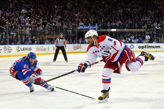 NEW YORK, NY - MAY 13:  Alex Ovechkin #8 of the Washington Capitals takes a shot against Carl Hagelin #62 of the New York Rangers in the first peroid in Game Seven of the Eastern Conference Semifinals during the 2015 NHL Stanley Cup Playoffs at Madison Square Garden on May 13, 2015 in New York City.  (Photo by Bruce Bennett/Getty Images)